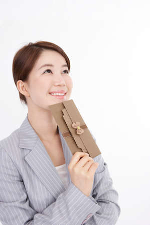 cropped shots: Cheerful young businesswoman holding greeting card