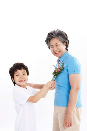 portraiture: Grandson giving flowers to grandmother