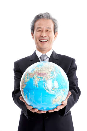 world at your fingertips: Businessman holding globe, smiling, portrait
