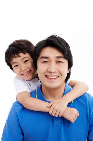 portraiture: Portrait of son embracing father