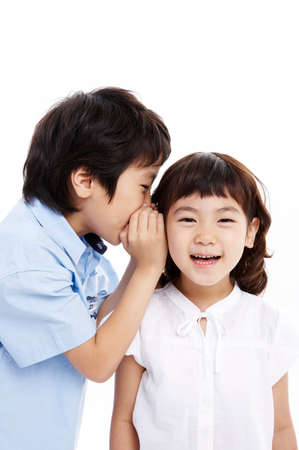 portraiture: Brother whispering into sisters ears