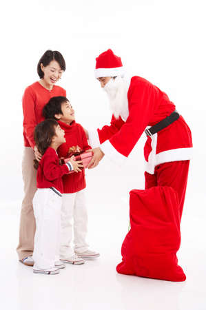 joyfulness: Santa Claus giving gift to children LANG_EVOIMAGES