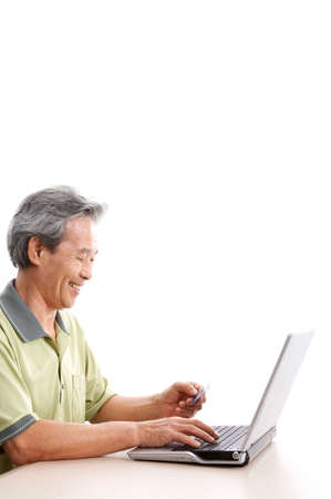 joyfulness: Mature man using laptop, smiling