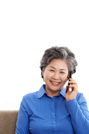 cheerfulness: Mature woman using mobile phone, smiling, portrait LANG_EVOIMAGES