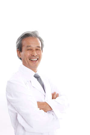 joyfulness: Male doctor standing with arms crossed, smiling, portrait