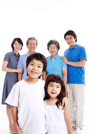 puerile: Portrait of family smiling together LANG_EVOIMAGES