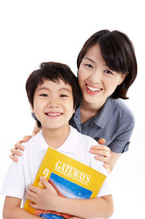 portraiture: Portrait of boy with mother holding book LANG_EVOIMAGES