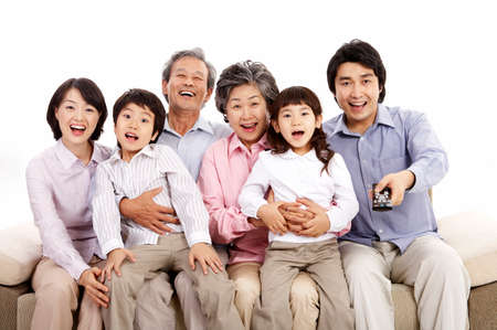 arts culture and entertainment: Portrait of family smiling together LANG_EVOIMAGES