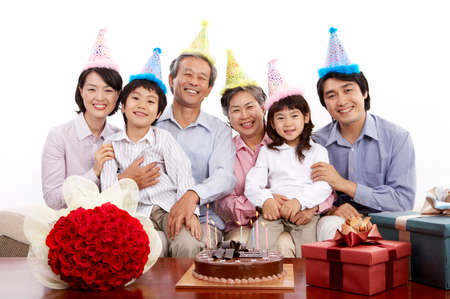 puerile: Portrait of a family having birthday party LANG_EVOIMAGES