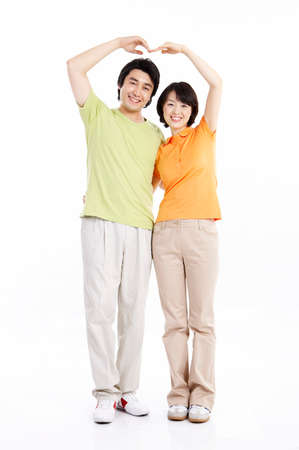 mid adult couple: Portrait of a mid adult couple with hands raised