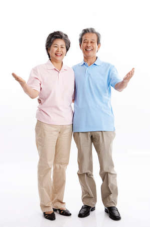 portraiture: Senior couple gesturing LANG_EVOIMAGES