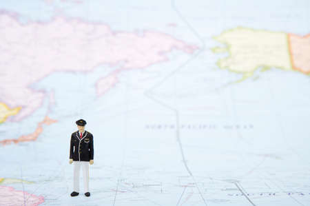 human representation: Businessman figurine standing over world map
