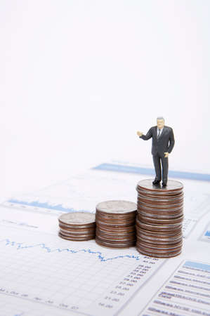 stock listing: Male figurine standing on stack of coins
