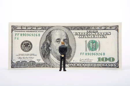 well made: Male figurine standing in front of US dollar