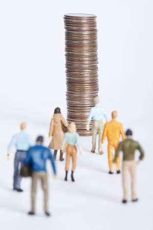 necessity: Figurines walking towards stack of coins