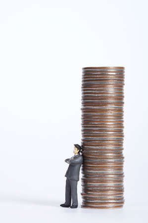 well made: Male figurine leaning on stacked coins