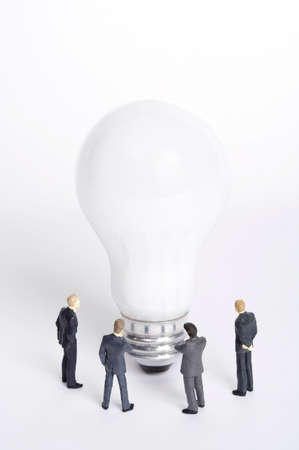 well made: Electric bulb surrounded by male figurines