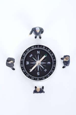 western script: Male figurines around compass