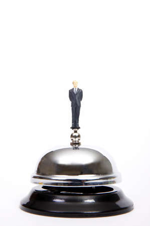 service bell: Businessman standing on service bell, close-up