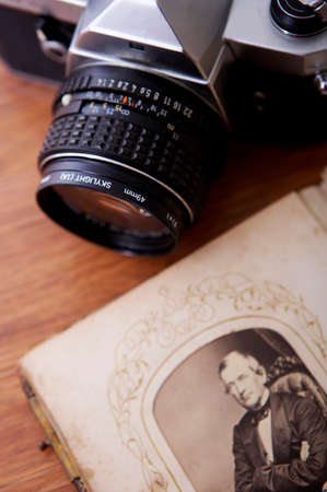 arts culture and entertainment: Close up of an old photo album with camera