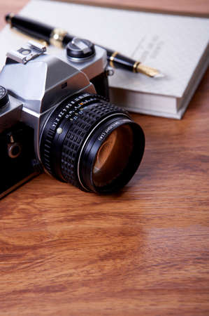 arts culture and entertainment: Camera, book and fountain pen, close up LANG_EVOIMAGES
