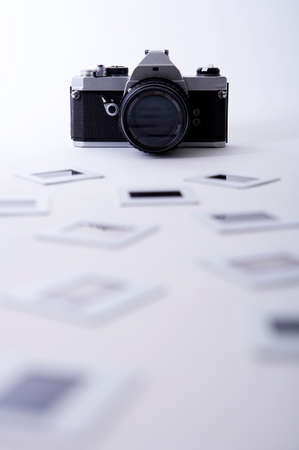 arts culture and entertainment: Vintage camera with negatives, close up