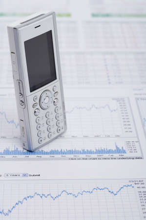 personal digital assistant: Mobile phone on a graph paper