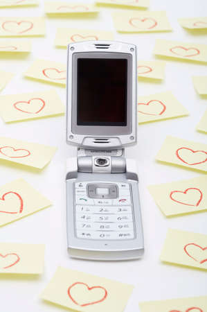 personal digital assistant: Mobile phone with heart on note against white background LANG_EVOIMAGES
