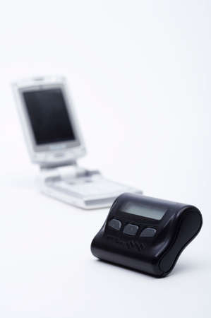 personal digital assistant: Mobile phone and pager against white background