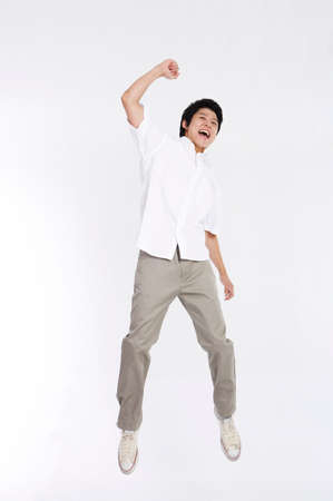 joyfulness: Young man jumping in air