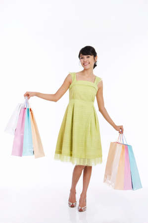 fair skin: Young woman holding shopping bags, portrait LANG_EVOIMAGES