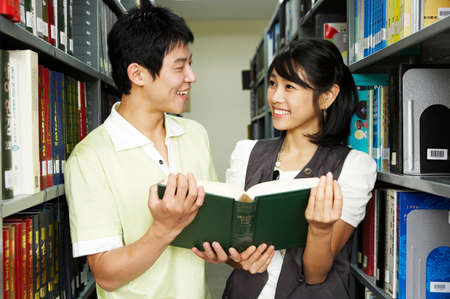 cheerfulness: Young couple in library, portrait