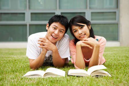 leisureliness: Young couple lying on grass, portrait