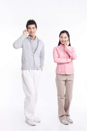 young man: Young man and woman using mobile phone