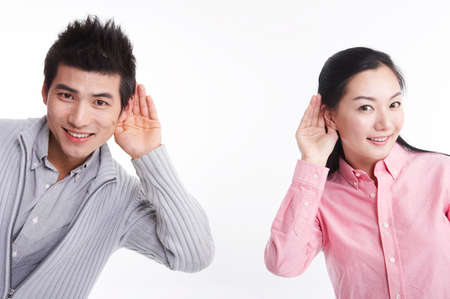 hands covering ears: Young man and woman with hands covering ears