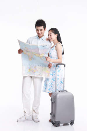 casual wear: Young couple looking at map