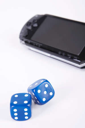 personal digital assistant: Mobile phone and dices against white background LANG_EVOIMAGES