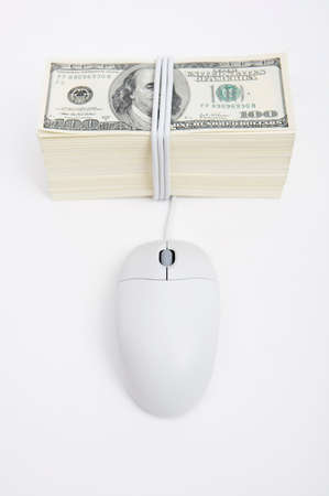 man made object: Computer mouse with US dollar bills LANG_EVOIMAGES