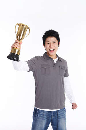 joyousness: Young man holding trophy, portrait