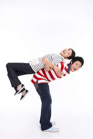fair skin: Young man giving young woman piggyback, portrait