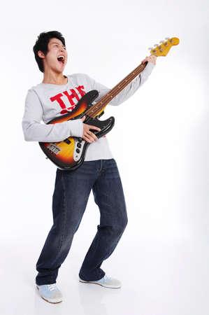 fair skin: Young man playing guitar,