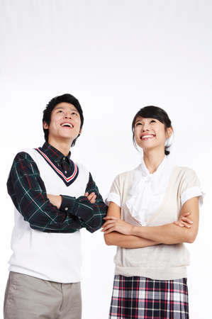 fair skin: Young couple looking up, smiling