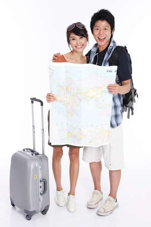 fair skin: Young couple holding world map, portrait