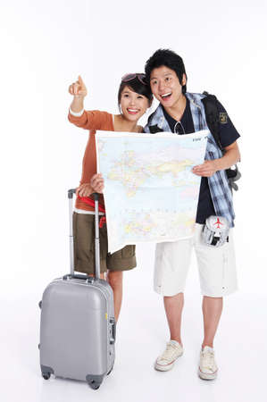 fair skin: Young couple discussing during traveling, smiling LANG_EVOIMAGES
