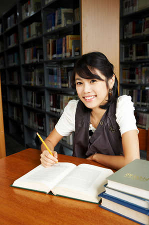 fair skin: Young woman studying in library, portrait