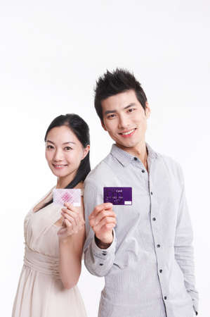 cheerfulness: Young couple holding credit card