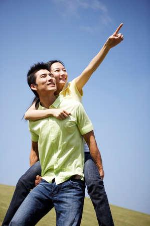 casual wear: Man giving woman piggyback