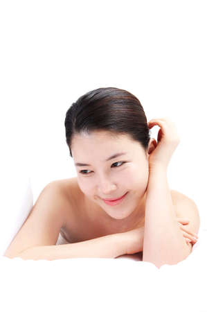 leisureliness: Young woman lying, close up
