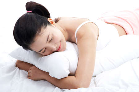 leisureliness: Young woman lying down hugging pillow