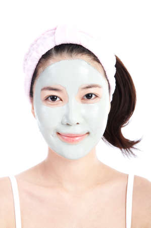 fair skin: Young woman applying face pack, close up